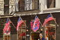 Four American flags waving in front of a Souvenir shop in New York City Royalty Free Stock Photo