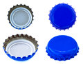 Four angles of blue colored metal caps used for glass soda bottles isolated on white background Stock Photography