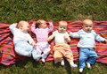Four babies Stock Images