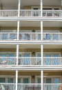 Four balconies with white railings on a story coastal condo Royalty Free Stock Images