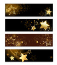 Four banners with stars horizontal banner gold on a dark background Royalty Free Stock Photo