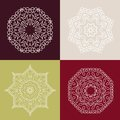 Four beautiful circular ornament on a colored background. Mandala. Stylized flowers. Vintage decorative elements.