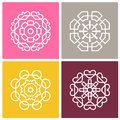 Four beautiful circular ornament. Mandala.Stylized flowers. Set of vector logos. Royalty Free Stock Photo