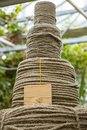 Four big hasps of Rough Cord made from natural plant flax fiber with mockup lable. Rope detail, closeup. Vertical Royalty Free Stock Photo
