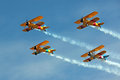 Four Biplanes Flying in Formation with Smoke Royalty Free Stock Photo