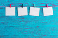 Four blank white notepads on blue crackle paint Royalty Free Stock Photo