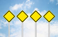 Four blank yellow traffic sign Royalty Free Stock Images