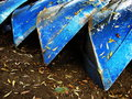 Four blue boats on the seashore Stock Image