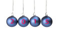 Four blue christmas balls with numbers of present year hanging in row isolated on white background Royalty Free Stock Photos