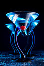 Four blue martini with cherry