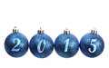 Four blue spangled christmas balls arranged in the year isolated on white background Stock Photo