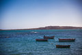 Four boats lying in a bay Royalty Free Stock Image