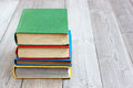 Four books in the colored cover on the table Royalty Free Stock Photo
