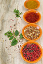 Four bowls with saffron, pepper, ras en hanout, fresh mint Royalty Free Stock Photo
