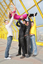 Four boys lift girl up Stock Images