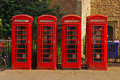 Four british red phone booth in cambridge Stock Images