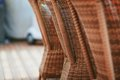 Four brown wooden rattan armchairs Royalty Free Stock Photo