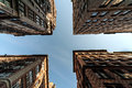 Four buildings overhead and the sky extreme perspective looking straight up from center of a street intersection with from every Stock Photo
