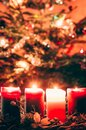 Four burning advent candles background Royalty Free Stock Photo
