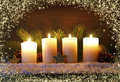 Four burning advent candles and luminous lights. Royalty Free Stock Photo