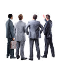 Four business mans from the back looking at something over a white background Stock Photography