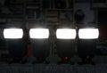 Four camera flashes lighting a dark room Stock Photos