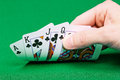 Four cards in the player s hand on green table Royalty Free Stock Images