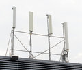 Four cellular towers on the roof Stock Photography