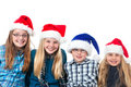 Four children with christmas hats smiling Stock Photography