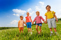 Four children holding hands and standing together Royalty Free Stock Photo