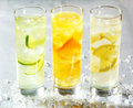 Four chilled citrus beverages Royalty Free Stock Photo