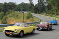 Four classic italian sports cars on road Royalty Free Stock Photo