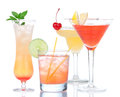 Four cocktail drinks yellow margarita cherry and tropical Martin Royalty Free Stock Photo
