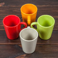 Four color tea cups empty arranged in cross Stock Photos