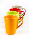 Four color tea cups empty arranged in one row Stock Image