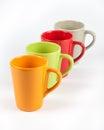 Four color tea cups empty arranged in one row Stock Photos