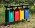 Four colored garbage containers Stock Photos
