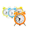 Four colorful alarm clocks Stock Photo