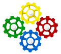 Four colorful gears in sync red yellow blue and green on white Royalty Free Stock Photo