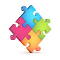 Four colorful puzzle (jigsaw) pieces