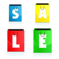 Four colorful shopping bags bearing the sale Royalty Free Stock Photo