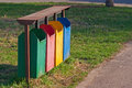 Four colors dirty recycle bins or trash can in the park Royalty Free Stock Photo