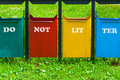 Four colors trash can in the park with inscription Royalty Free Stock Photo