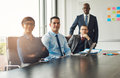 Four confident successful business partners Royalty Free Stock Photo