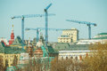 Four cranes above the center of Moscow. Royalty Free Stock Photo