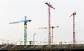Four cranes on building site in Hamburg. Industrial area. Royalty Free Stock Photo