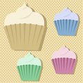 Four cute multicoloured cupcake stickers on a beige polkadot background with dpor shadows Stock Images