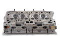Four cylinder engine head on white Stock Photos