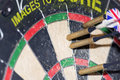 Four darts in dartboard the bed of a Royalty Free Stock Photos