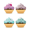 Four dessert cupcakes in different colors Royalty Free Stock Image